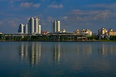 Putrajaya lake with residential area and skyscrapers royalty free stock photography