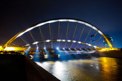Putrajaya, Malaysia Cityscape. A landmark bridge over a dam in Putrajaya, Malaysia at night Royalty Free Stock Photos