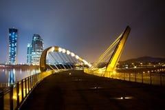 Putrajaya, Malaysia Cityscape. A landmark bridge over a dam in Putrajaya, Malaysia at night stock photo