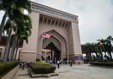 Putra Mosque at downtown in Putrajaya, Malaysia. Putrajaya, Malaysia - Jul 7, 2015. People visit the Putra Mosque in Putrajaya, Malaysia. The mosque is one of Royalty Free Stock Image