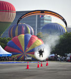 Paramotor squad flying during 5th Putrajaya International Hot Air Balloon Fiesta 2013 Stock Photos