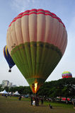 5th Putrajaya International Hot Air Balloon Fiesta. PUTRAJAYA, MALAYSIA - MARCH 30:A tethered hot air balloon floats on the air during 5th Putrajaya Royalty Free Stock Image