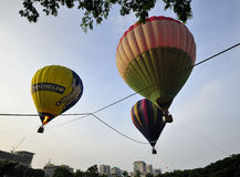 5th Putrajaya International Hot Air Balloon Fiesta 2013. PUTRAJAYA, MALAYSIA - MARCH 30:Three tethered hot air balloon floating on the air during 5th Putrajaya Royalty Free Stock Photo