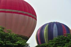 5th Putrajaya International Hot Air Balloon Fiesta 2013. PUTRAJAYA, MALAYSIA - MARCH 29:Two tethered balloons fully inflated during 5th Putrajaya International Royalty Free Stock Images
