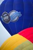 5th Putrajaya International Hot Air Balloon Fiesta 2013. PUTRAJAYA, MALAYSIA - MARCH 29:Two tethered hot air balloon ascends up during 5th Putrajaya stock photo