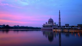 Timelapse video of sunset at Putra Mosque (Masjid Putra) during haze weather. 29 frame rates clips. Putrajaya, Malaysia - October 9, 2019 : Timelapse video of stock video