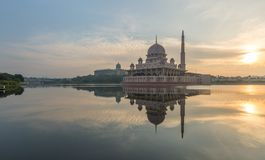Putrajaya Mosque capture at Sunrise with a reflection on water. Early morning light of sunrise upon the Putrajaya Mosque in Kuala Lumpur Malaysia. The reflection Royalty Free Stock Photo