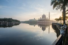 Putrajaya Mosque capture at Sunrise with a reflection on water. Early morning light of sunrise upon the Putrajaya Mosque in Kuala Lumpur Malaysia. The reflection Stock Photography