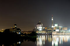 Putrajaya mosque at night. Close up view of Putrajaya mosque at night taken by the lake from the bridge Royalty Free Stock Image