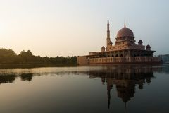 Putrajaya mosque between sunsire in Kuala Lumpur, Malaysia. Pink mosque royalty free stock photography