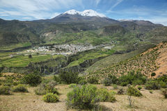 Putre village with  Nevado de Putre at background. Putre village with Nevado de Putre at background, Chile Stock Photography