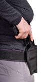 Puts the gun in the holster stock photos