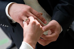 Puts on a wedding ring. The bride puts on a wedding ring to finger of the beloved Royalty Free Stock Image