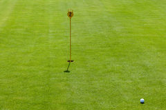 Putt at golf course Stock Image