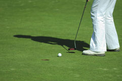 Putt on golf course. Putt on golf green course Royalty Free Stock Images