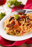 Puttanesca pasta. With tomato sauce and olives stock photography