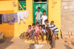 PUTTAPARTHI, ANDHRA PRADESH, INDIA - JULY 9, 2017: Group of indian boys in the street. Copy space for text. Stock Photos