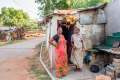 PUTTAPARTHI, ANDHRA PRADESH, INDIA - JULY 9, 2017: Indian women near the building. Copy space for text. PUTTAPARTHI, ANDHRA PRADESH, INDIA - JULY 9, 2017 stock photos
