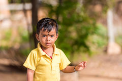 PUTTAPARTHI, ANDHRA PRADESH, INDIA - JULY 9, 2017: Portrait of an indian boy outdoors. Copy space for text. Royalty Free Stock Photo