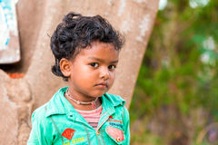 PUTTAPARTHI, ANDHRA PRADESH, INDIA - JULY 9, 2017: Portrait of Indian cute girl on the street. Close-up. royalty free stock photo
