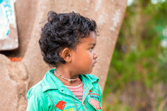 PUTTAPARTHI, ANDHRA PRADESH, INDIA - JULY 9, 2017: Portrait of Indian cute girl on the street. Close-up. stock photo