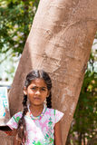PUTTAPARTHI, ANDHRA PRADESH, INDIA - JULY 9, 2017: Portrait of  Indian cute girl on the street. Close-up. Vertical. Stock Photos
