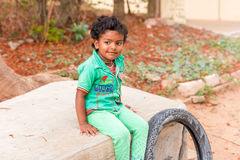 PUTTAPARTHI, ANDHRA PRADESH, INDIA - JULY 9, 2017: Portrait of Indian cute girl on the street. Copy space for text. stock photography