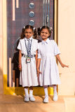 PUTTAPARTHI, ANDHRA PRADESH, INDIA - JULY 9, 2017: Two little Indian girl in a school uniform. Vertical. Copy space for text. Stock Image