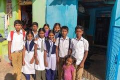 PUTTAPARTHI, ANDHRA PRADESH - INDIA - NOVEMBER 09, 2016: Indian school children are posing on the street. PUTTAPARTHI, ANDHRA PRADESH - INDIA - NOVEMBER 09 Stock Photos