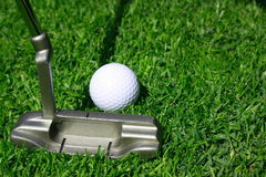 Putter. With golf ball on a grass Royalty Free Stock Photos