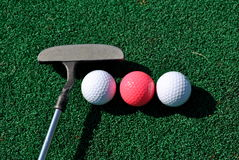 Putter and balls royalty free stock photo
