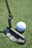 Putter e verde di golf Immagini Stock