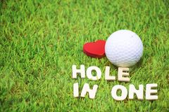 Putter and golf ball on green background. Putter and golf ball are on green background Stock Photography