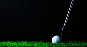 Putter and golf-ball on green grass Royalty Free Stock Images