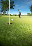 Putting. Golfer putting at golf course, shallow depth of field Stock Photos