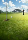 Putting. Golfer putting at golf course, shallow depth of field Royalty Free Stock Images