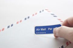 Putting air mail tag Stock Photo
