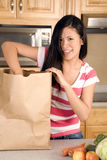 Putting arm in bag Royalty Free Stock Image