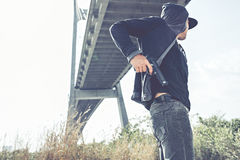 Putting away pistol Stock Image