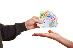 Putting banknotes on hand Royalty Free Stock Photos