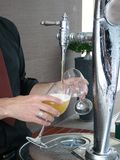Putting beer from a faucet Royalty Free Stock Photos