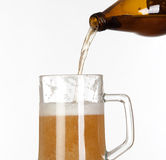 Putting beer in a glass jar Stock Photo