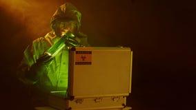 Putting a bio-hazard sample into a protective case Stock Photos