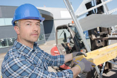 Putting block wood on forklift. Putting block of wood on the forklift Stock Images