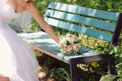 Putting Bouquet on Bench Stock Image