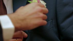 Putting a Boutonniere Into Pocket stock footage