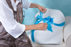 Putting a bow on a pregnancy belly cast Royalty Free Stock Photography
