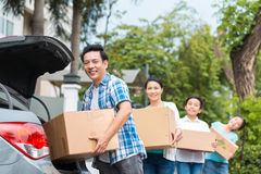 Putting boxes in the car Royalty Free Stock Photo
