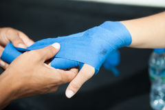 Putting boxing bandage on Woman hand Royalty Free Stock Photography