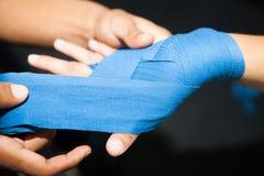 Putting boxing bandage on Woman hand Royalty Free Stock Photos